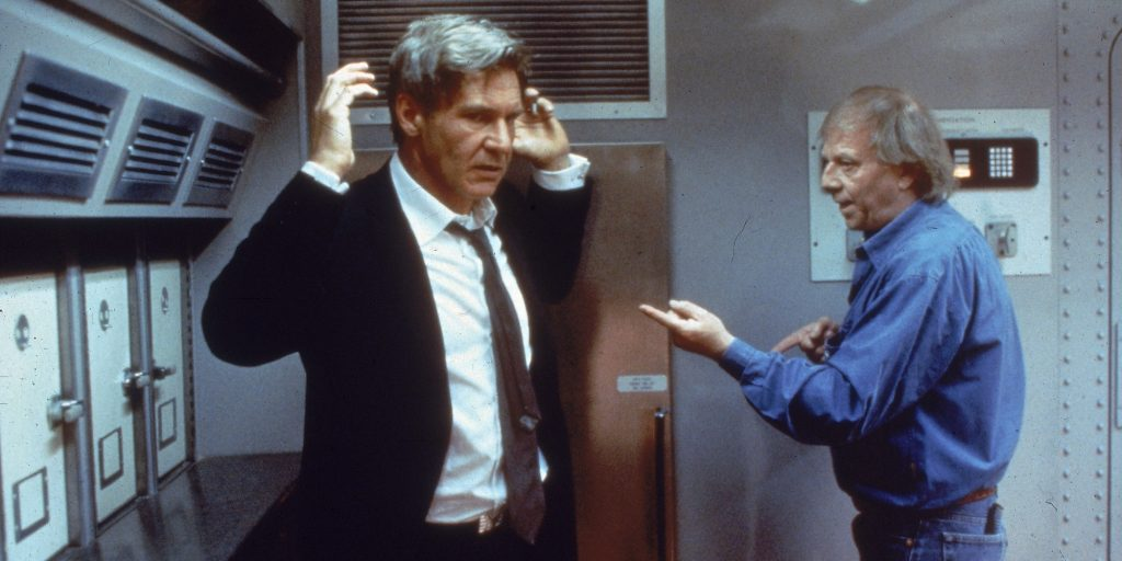 1997:  German-born director Wolfgang Petersen (right) instructs American actor Harrison Ford on the set of Peterson's film, 'Air Force One.'  (Photo by Columbia Pictures/Fotos International/Getty Images)